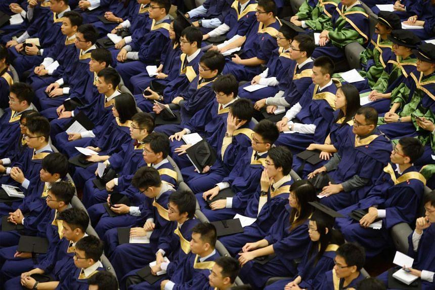 National University of Singapore (NUS) graduates attending their National University of Singapore (NUS) Commencement ceremony.