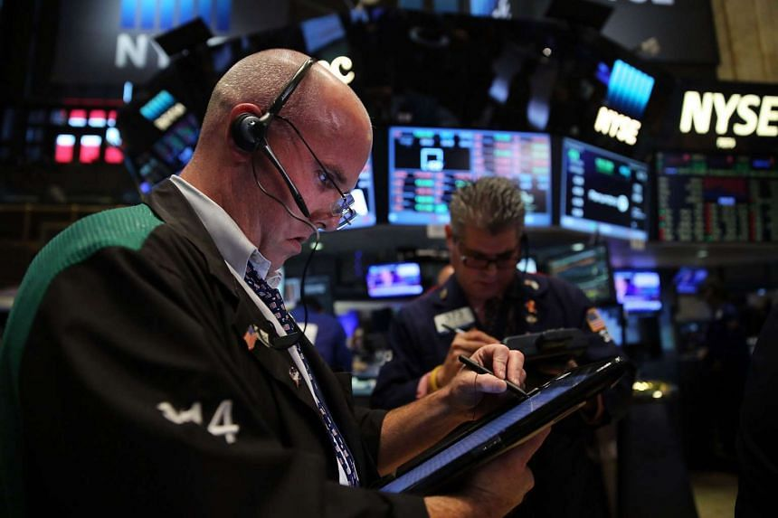 A file picture of traders work on the floor of the New York Stock Exchange (NYSE) in New York City.  PHOTO: AFP