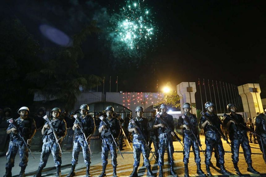 Nepalese armed police stand guard while fireworks are displayed after President Ram Baran Yadav unveiled the new Nepal Constitution at the Constitution Assembly hall in Kathmandu, Nepal, 20 September 2015. Several ethnic communities of Nepal includin