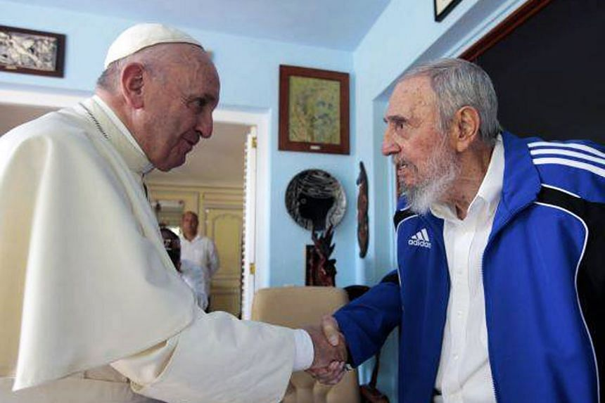 Former Cuban president Fidel Castro (right) shaking hands with Pope Francis in Havana on Sunday, in a photo released by released by Cuban website Cubadebate.cu.