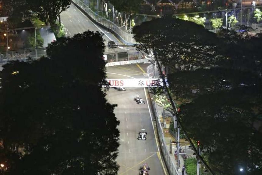 Drivers speeding down Stamford Road after Turn 8, as seen from Swissotel The Stamford.