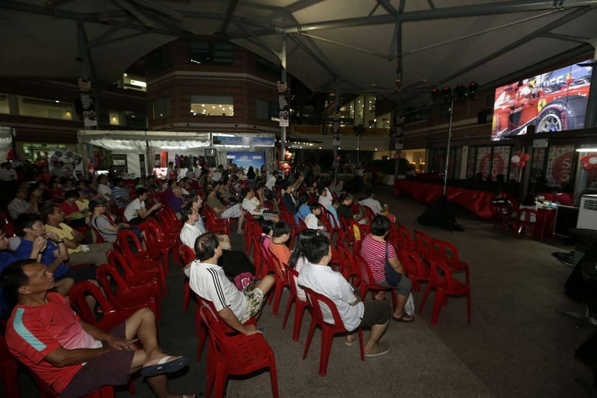 The public enjoying the screening on a 220-inch high-definition LED Video Wall at the Bishan Community Club.