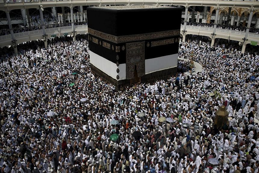 Muslim pilgrims praying around the holy Kaaba at the Grand Mosque on Sept 21, 2015.