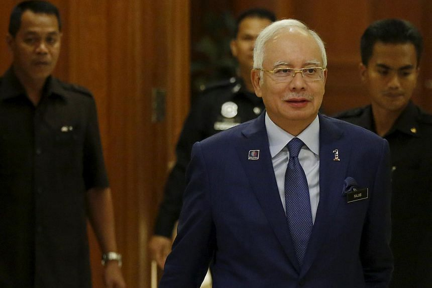Malaysia's PM Najib Razak arrives with his security detail at a news conference in Putrajaya, Malaysia, on Sept 14, 2015.