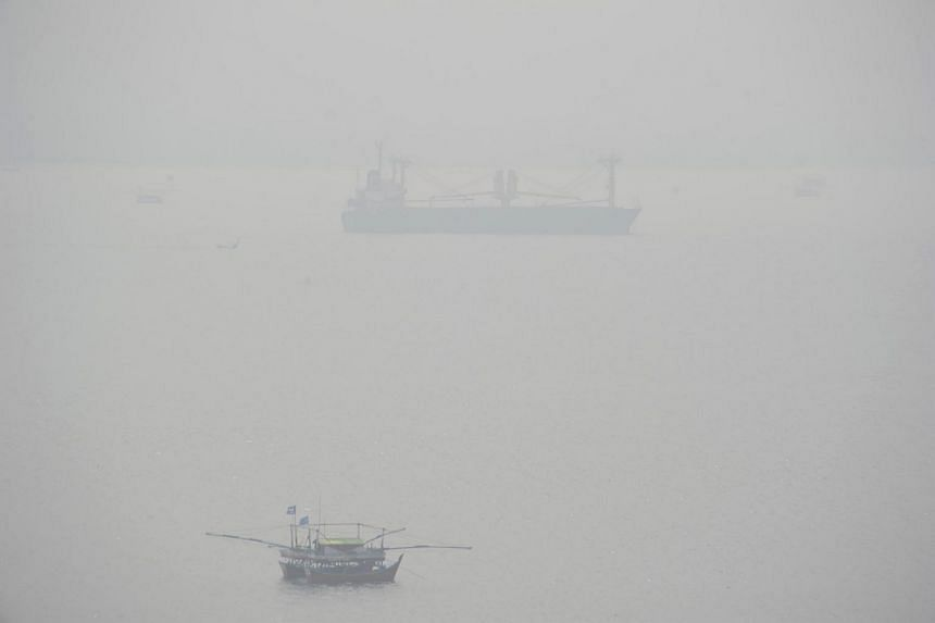 Thick haze shrouds a local port in Malahayati, in the city of Banda Aceh on Indonesia's Sumatra island on Sept 19, 2015.
