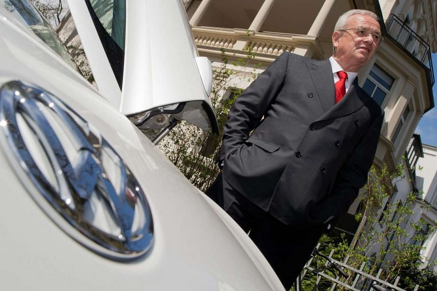 Martin Winterkorn, CEO of Volkswagen AG, stands by a Volkswagen XL1 in this April 22, 2015 file photo.