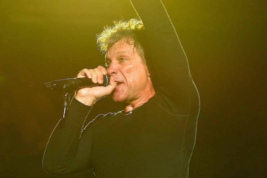Jon Bon Jovi struggled to hit the high notes, but he worked the stage and the crowd like a consummate professional.