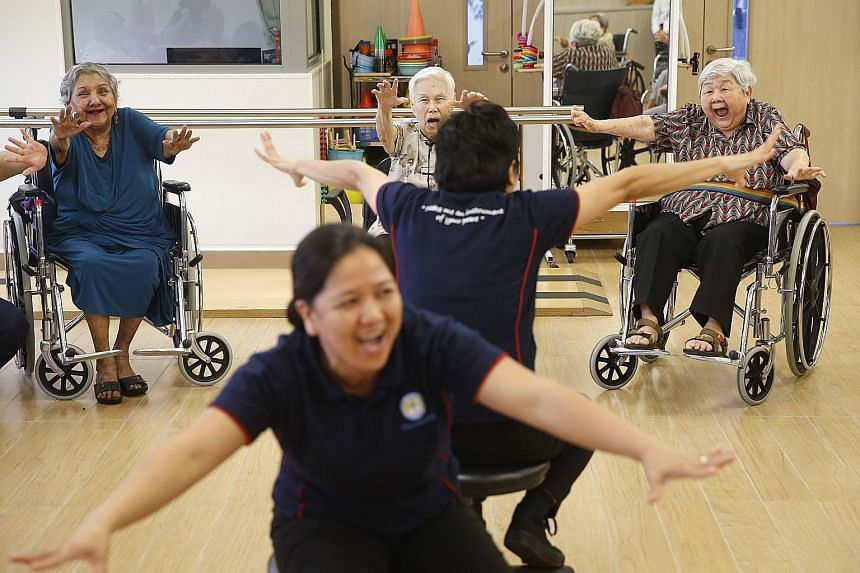Ms Mary Tan, 82, joins other residents in a creative movement module led by healthcare staff at Villa Francis Home for the Aged. Ms Tan says she enjoys the exercise even though she does not like dancing.