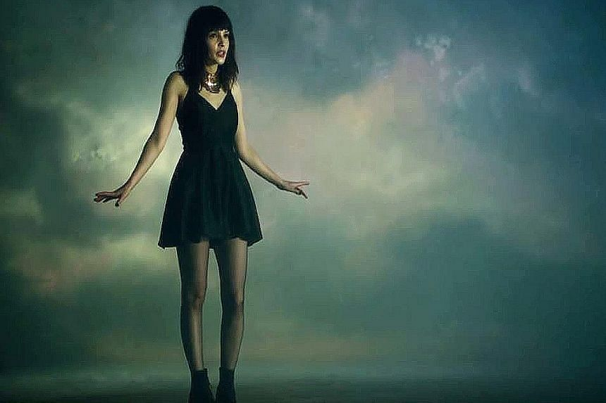 Chvrches' lead singer Lauren Mayberry was a target of sexually offensive comments after appearing in a short black dress in the music video of Leave A Trace (left).