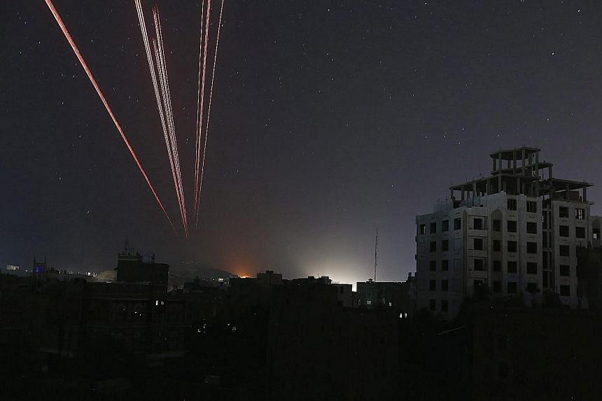 The sky over a Sanaa neighbourhood is illuminated by anti-aircraft fire as the Saudi-led coalition intensified airstrikes on Houthi positions in the capital of Yemen yesterday. The Saudi-led forces are trying to restore exiled President Abedrabbo Man