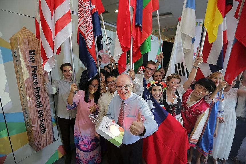 It was all peaceful, but certainly not quiet, at the Singapore Management University (SMU) campus yesterday as the university celebrated the United Nations' International Day of Peace. Students of about 40 nationalities dazzled with a colourful displ