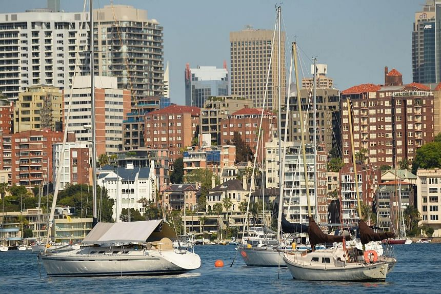 Apartment buildings lining the harbourfront in Sydney. Australian property prices, particularly in Sydney and Melbourne, have soared in recent years. But demand is now sliding. Auction clearance rates in Sydney dropped to about 73 per cent for the we