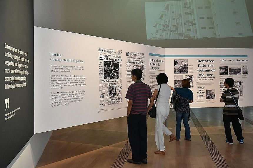 Visitors at The Straits Times' exhibition at the ArtScience Museum. According to an ongoing visitors' survey, those who have seen the exhibition gave it an average rating of 4.07 out of five points.