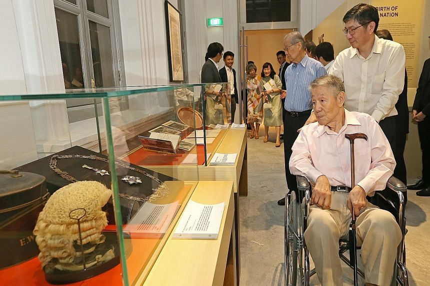 Former labour minister Jek Yeun Thong (right, seated), his son Jek Kian Yee, and former education minister Ong Pang Boon (centre, in blue shirt) at the preview of the National Museum's new exhibition called We Built A Nation, which chronicles the con
