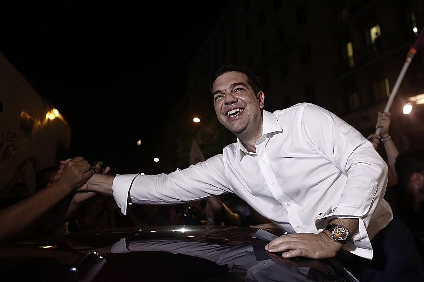 Greek Prime Minister Alexis Tsipras being congratulated on Sunday on winning the country's latest election. The news had little impact on Asian markets as investors now have other concerns on their minds, such as an economic slowdown in China and whe