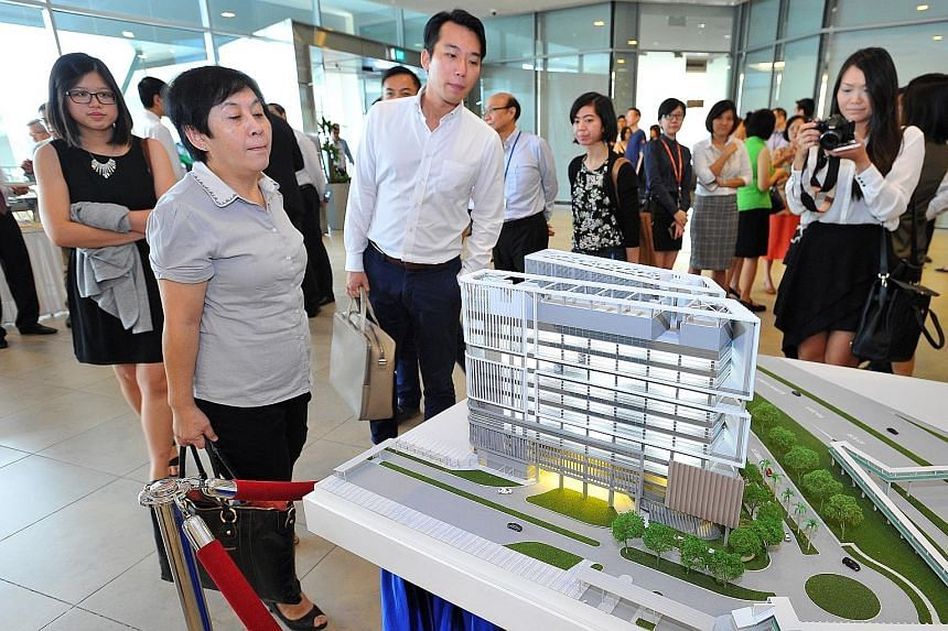 A model of the National University Centre for Oral Health, which will open in 2019 at Kent Ridge. It will focus on complicated cases, such as treatment for transplant patients, as well as dental care for the elderly.