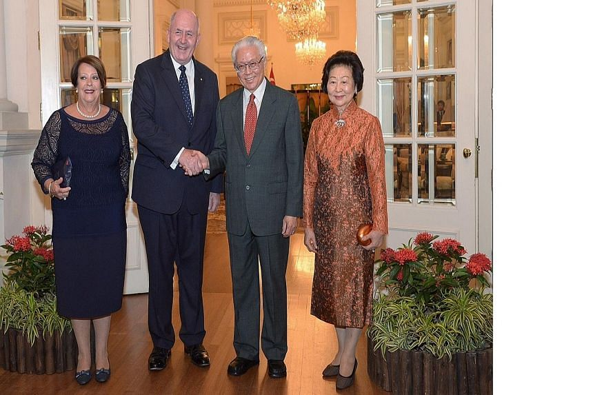 President Tony Tan Keng Yam and his wife Mary welcoming Australia's Governor-General Peter Cosgrove and his wife, Lady Lynne Cosgrove, at the Istana yesterday during their four-day visit to the Republic.