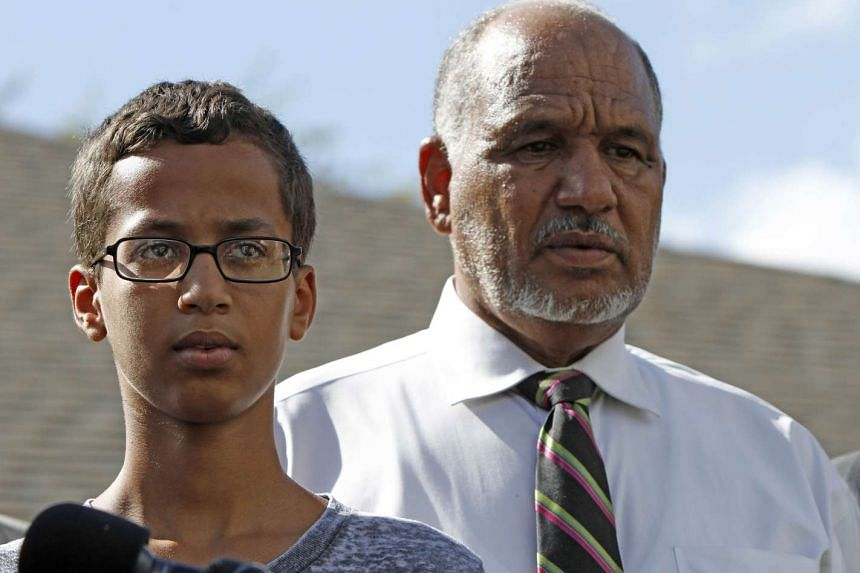 Ahmed Mohamed stands with his father, Mohamed Elhassan Mohamed, during a news conference on Sept 16.