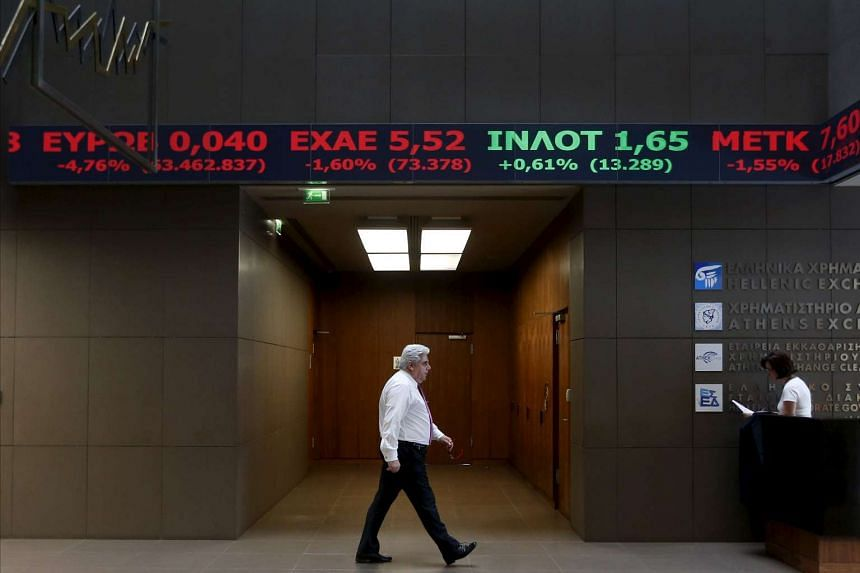 An employee walking inside the Athens stock exchange building on Sept 21, 2015.