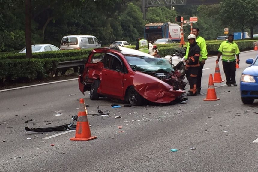 A red Honda believed to be driving against traffic was involved in an eight-car pile up on the Ayer Rajah Expressway on Sept 21, 2015.