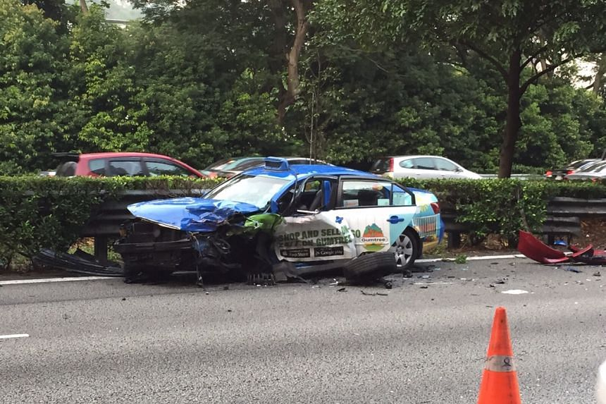 A red Honda believed to be driving against traffic crashed into a taxi, and seven other cars on the Ayer Rajah Expressway on Sept 21, 2015.