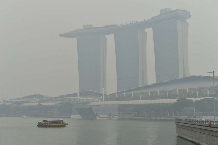 The Marina Bay Area shrouded in haze at around 2pm on Sept 22, 2015.