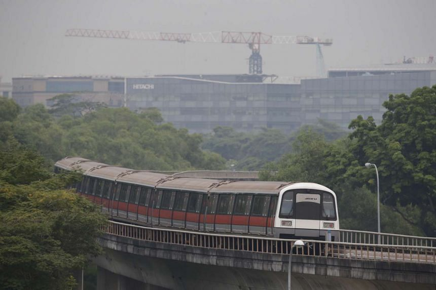 A SMRT train travels towards Tampines MRT station in hazy conditions at around 5pm on Sept 22, 2015.