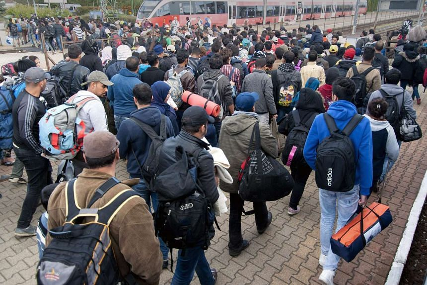 Migrants arriving at the railway station in Budapest, Hungary, on Sept 21, 2015.