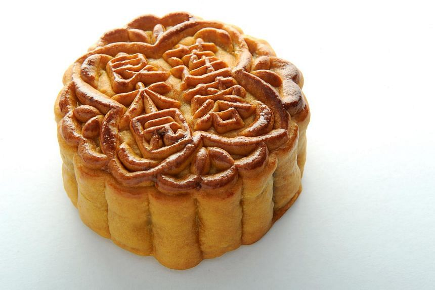 Mooncakes, usually round in shape with a sweet filling such as lotus seed paste, are Chinese pastries enjoyed during the Zhongqiu Jie or mid-autumn festival.