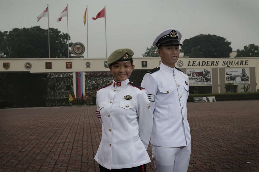 Graduands of the 24th Specialist Cadet Course at Pasir Laba Camp, from left: SCT Amanda Thea Tan Hui Xuan and SCT Tee Qian Jiang. They each received a Silver and Golden Bayonet.