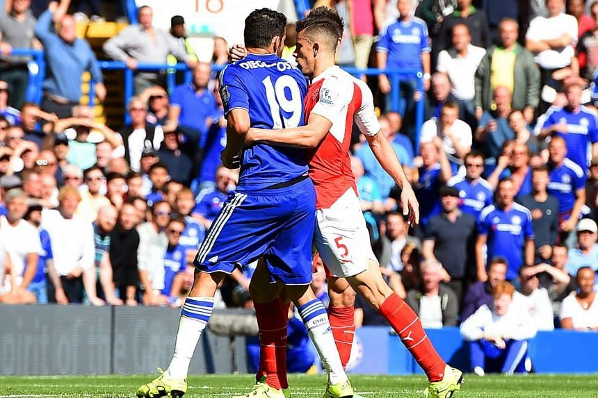 Chelsea's Diego Costa (left) has an altercation with Arsenal's Gabriel Paulista (right) resulting in Gabriel being sent off during the English Premier League soccer match between Chelsea FC and Arsenal FC at Stamford Bridge in London on Saturday.