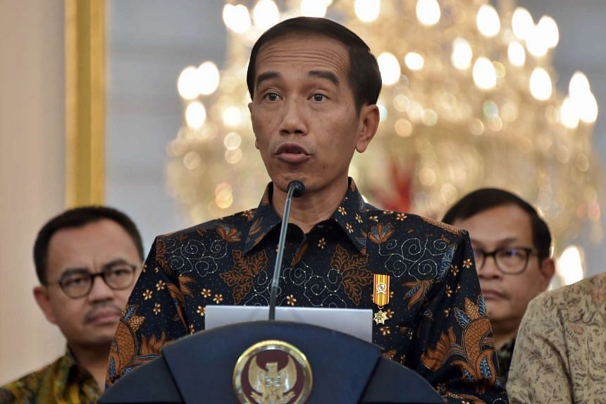 Indonesia's President Joko Widodo delivers a statement on the economy  in Jakarta on Sept 9,