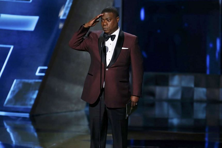 Comedian Tracy Morgan, who was involved in a serious car accident last year, returned to the stage to present the best drama award.