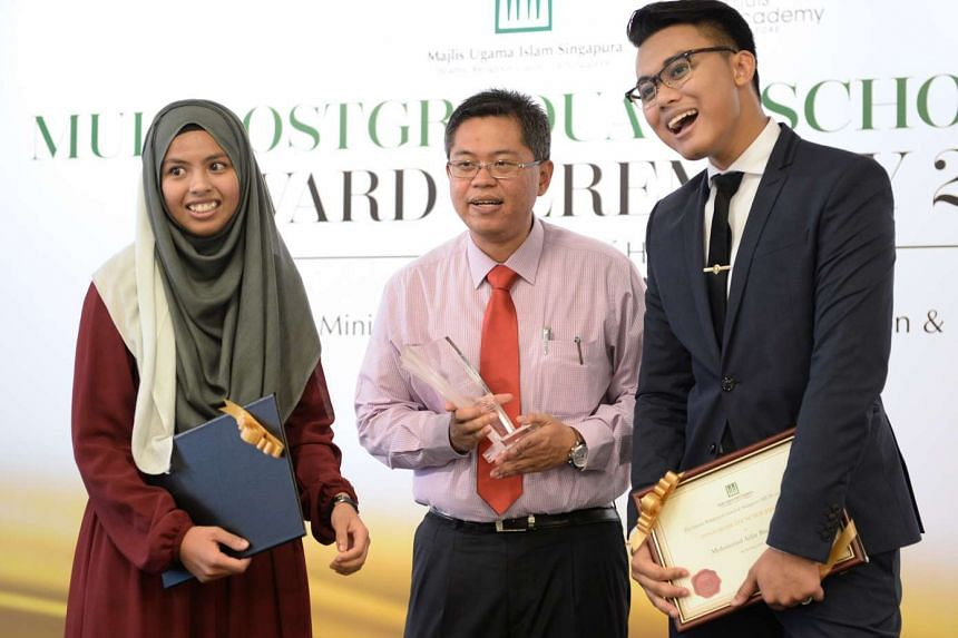 Dr Norshahril Saat (centre) won the first Syed Isa Semait Scholar Award yesterday while Ms Muneerah Abdul Razak received a Muis financial grant, and Mr Muhammad Azfar Anwar was given the Muis Postgraduate Scholarship Award.