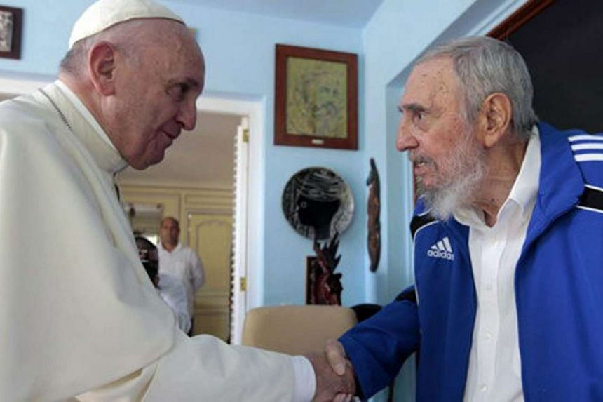 Pope Francis riding past the Catholic faithful in Havana's Revolution Square on Sunday, after holding the first Mass of his visit to Cuba. He also met and discussed religion and world affairs with revolutionary leader Fidel Castro (above).