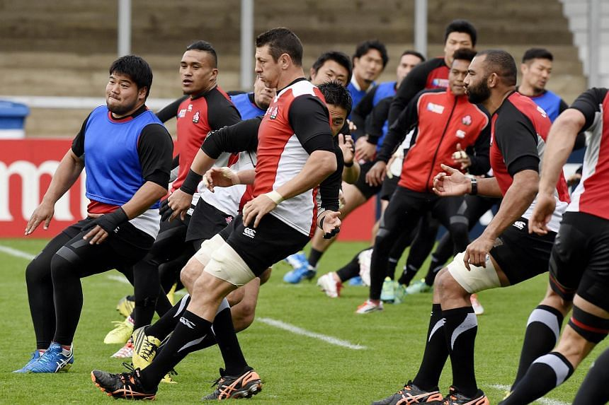 Japan's Michael Leitch (right) and Luke Thompson (centre) during a training session at the Kingsholm Stadium.