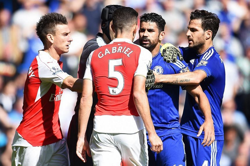 Chelsea's Diego Costa (second from right) has an altercation with Arsenal's Gabriel Paulista (centre).