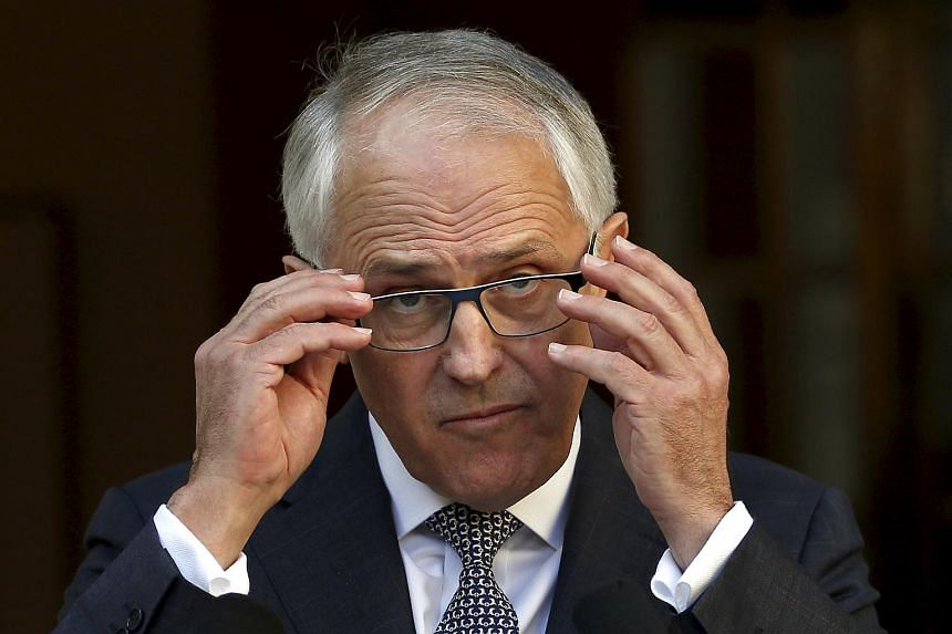 Malcolm Turnbull listens to a question after announcing his new federal cabinet during a media conference at Parliament House in Canberra, Australia, on Sept 20, 2015.