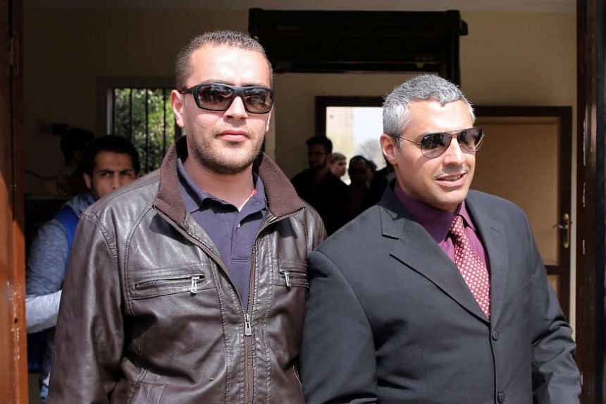 Canadian-Egyptian journalist Mohammed Fahmy (right) and his colleague Baher Mahmoud (left) after a trial session in Cairo, Egypt in this March 8, 2015 file photo.