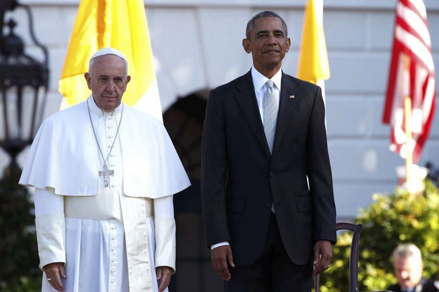 U.S. President Barack Obama stands with Pope Francis as the pontiff is welcomed to the White House during a ceremony in Washington on Sept 23, 2015.