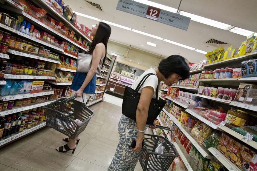Shoppers browsing the shelves in a supermarket in Singapore.