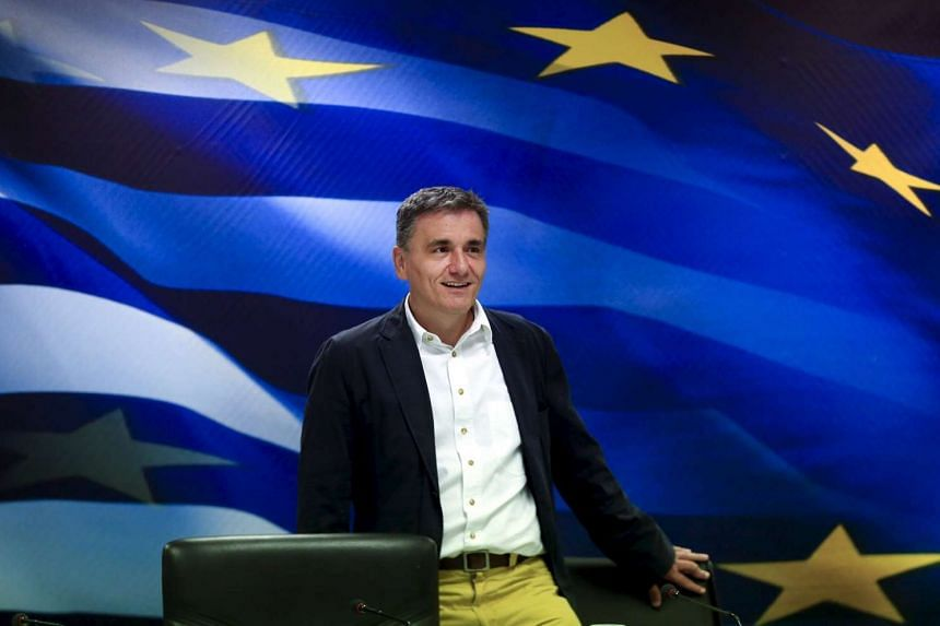 Euclid Tsakalotos arriving for a handover ceremony at the ministry in Athens, on Aug 28, 2015.