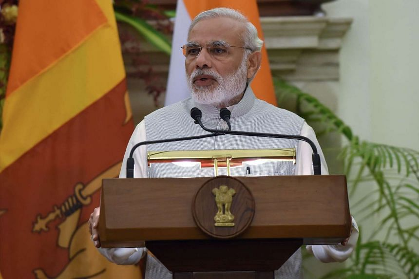 Indian Prime Minister Narendra Modi addresses a joint press conference with Sri Lankan Prime Minister Ranil Wickremesinghe following their meeting in New Delhi on Sept 15, 2015.