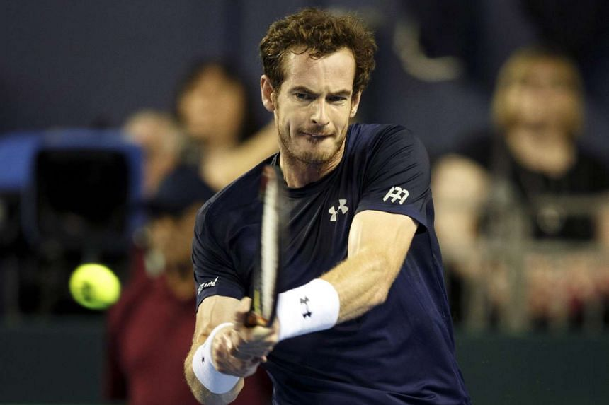 Britain's Andy Murray in action against Australia's Bernard Tomic during the Davis Cup semi final tie between Britain and Australia at the Emirates Arena in Glasgow, Britain on Sept 20, 2015.