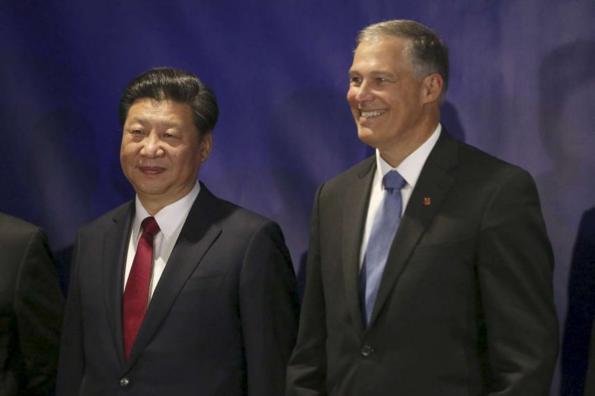 Washington Governor Jay Inslee stands next to Chinese President Xi Jinping before a forum for US and Chinese governors on the first day of President Xi's trip to Seattle, Washington on Sept 22, 2015.