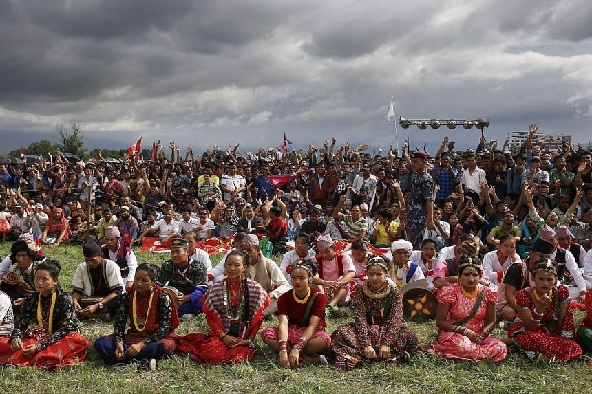 Nepalese in indigenous attire attending a celebration to welcome the country's new Constitution in Kathmandu, Nepal on Monday. Nepal formally adopted a new Constitution, turning the former Himalayan monarchy into a secular democracy. Several ethnic c