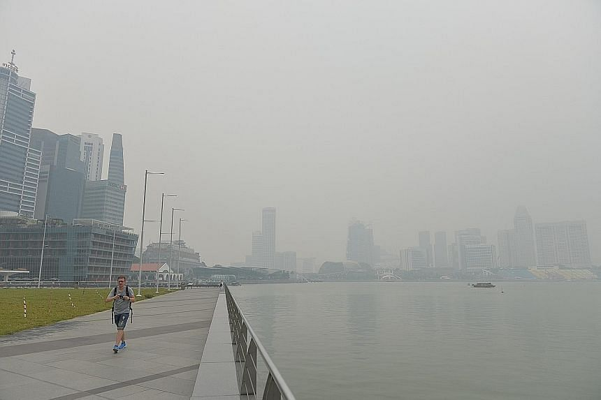 The Singapore skyline obscured by haze in the Marina Bay area at around 2pm yesterday. The 24-hour PSI stood at 85-103 at 5pm yesterday, in the moderate to unhealthy ranges.