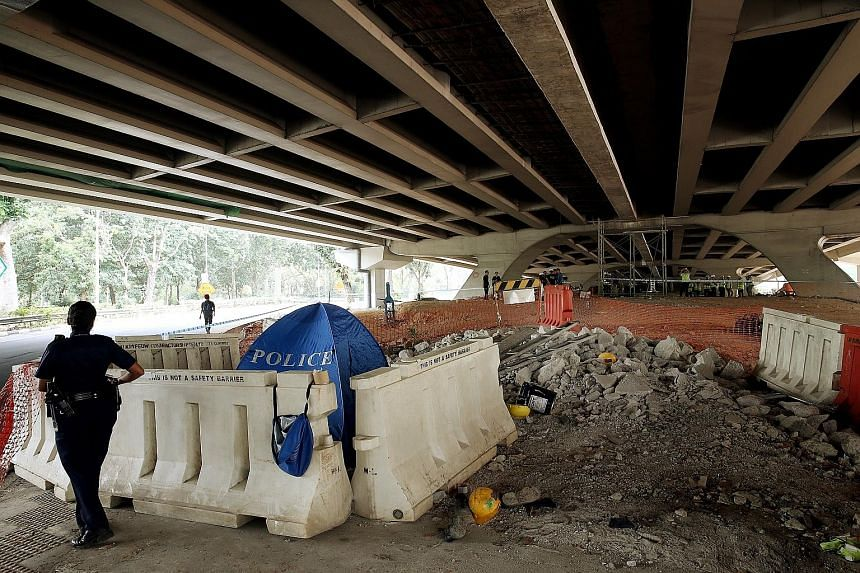 Four construction workers fell from a temporary working platform below the Yio Chu Kang flyover yesterday.