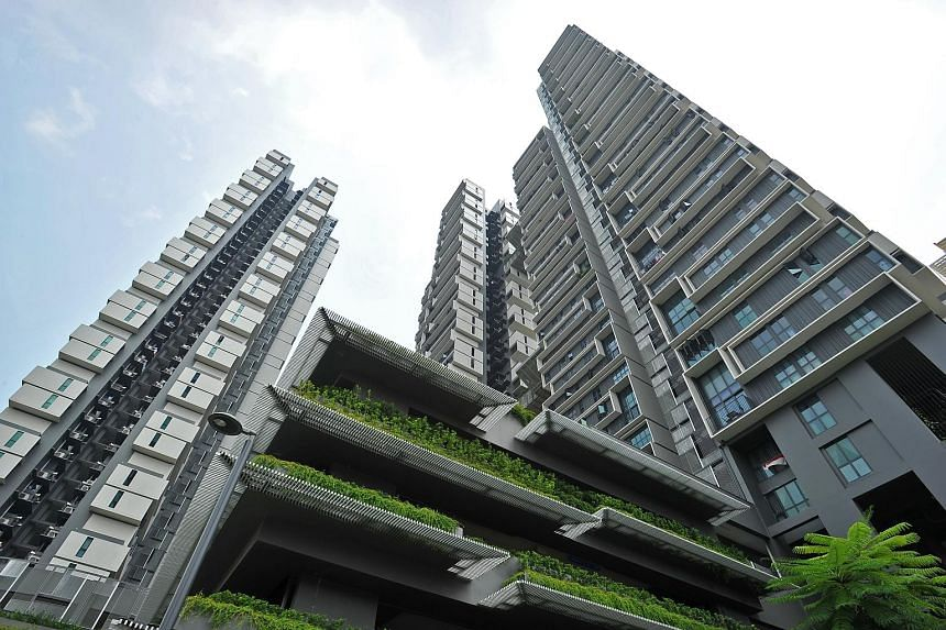 Mr Cheah Tse Boon (above) with his wife, Ms Jean Foo, and their son Elias, in their paired unit which consists of five-room loft unit with studio apartment. The development (right) has green roof terraces and terraced planting which dangles over its