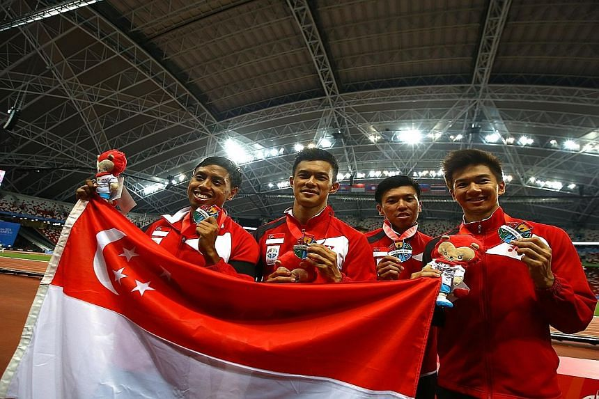 (From left) Amirudin Jamal, Lee Cheng Wei, Gary Yeo and Calvin Kang with their SEA Games silver medals in June. They clocked a 4x100m national record of 39.24sec. Amirudin, Lee, Yeo and reserve Elfi Mustapa have retired, leaving only Kang and reserve